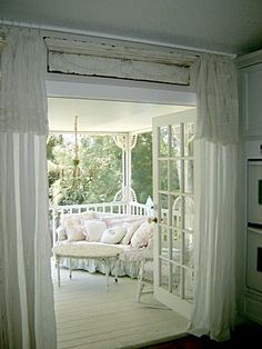 summer porch..love the architectural salvage piece above the doors, something so simple, yet adds such a bit of character...