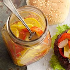 From Better Homes and Gardens - So-Sweet Squash Pickles  Zip up a boring burger, hot dog, sandwich, or pasta salad with some of these summer squash pickles. For the best pickles, choose smaller squash with brightly colored skin and without bruises or cuts.
