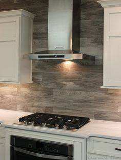 Stainless Steel #appliances always look right at home in a #gray #kitchen design concept.   |   VillageHomeStores.com
