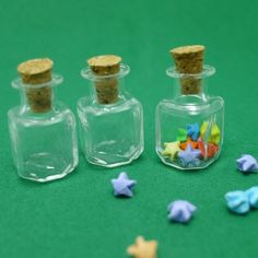 """Miniature bottle filled with origami stars I couldn't tell whether to put it with the """"Origami"""" section or """"Glass Bottles"""" section XD"""
