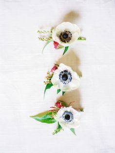 Pretty anemone boutonnieres: http://www.stylemepretty.com/california-weddings/lake-tahoe-ca/2016/02/01/whimsical-al-fresco-lake-tahoe-wedding-at-the-hideout-inn/   Photography: Coco Tran - http://www.cocotran.com/