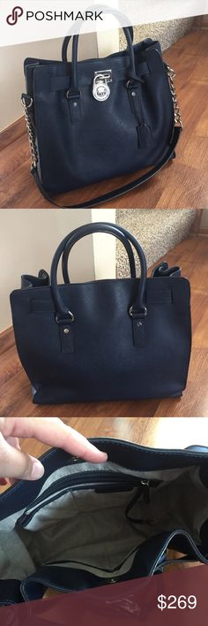 Michael Kors Navy large Hamilton bag with silver Michael Kors Navy Large Hamilton bag with silver hardware! Excellent condition inside and out. Mild wear to bottom hardware. Beautiful purse in a great color for everyday use! Michael Kors Bags Satchels