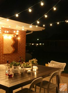 An outdoor dining area is the perfect spot for a romantic night in, especially with hanging bistro lights