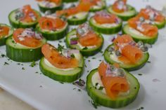 Smoked salmon cucumber chips with capers, red onion and dill sauce