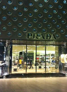 Exterior to Prada store, IFC Mall, Shanghai by Double Stone Steel Interior Fit Out, Stone Interior, Retail Interior, Interior And Exterior, Aluminium Cladding, Revolving Door, Retail Fixtures, Corten Steel, Shop Interiors