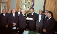 1964-09-24 Earl Warren presents the 888 page Commission Report on the assasination of JFK to LBJ