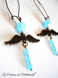 """Boucles d'oreille longues """" Mon ange """" ailes d'ange en bronze , perles rondes en verre à facettes opaque bleu ciel : Boucles d'oreille par les-creations-de-melletincelle"""