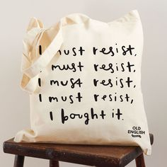 This simple and stylish shopping tote bag would be the perfect gift for the shopaholic friend! The typographic tote bag has been illustrated with the hand lettered words 'I must resist, I must resist, I must resist, I must resist... I bought it'. This fun tote bag is perfect for shopping. The tote bag is very hard wearing. The tote bag would make a great gift!