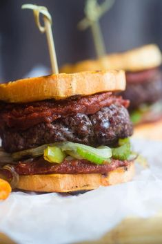 Healthy Cajun Burgers - These crowd-pleasing burgers use grilled sweet potatoes as buns instead of bread! They're a healthy gluten and dairy free summer meal for only 300 calories!   Foodfaithfitness.com   @FoodFaithFit