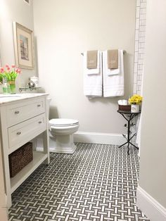 Bye-Bye Builder's Grade - Bathroom Renovation Love the floor tile!