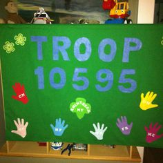 First meeting: Girl Scout Troop banner.  Discount fabric, dowel, iron on letters & felt.  Have girls trace their hands.  Banner for parades or to make any room seem like an official meeting spot!