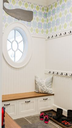 Mud Room. Coastal Mud room. Coastal mud room. Small coastal mud room. The mudroom boasts blue and green ikat wallpaper on upper walls and beadboard trim on lower walls. #Mudroom #Coastal #Smallspaces Brookes and Hill Custom Builders.