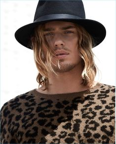 A rock 'n' roll vision, Ton Heukels wears a LE 31 leopard print sweater with a Brixton hat.