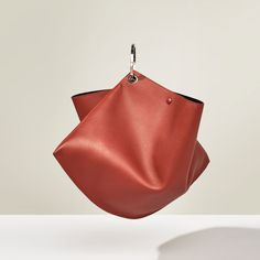 Image 2 of STUDIO LEATHER MAXI BUCKET BAG WITH HOOPS from Zara