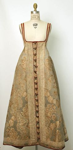 Russian sarafan. 19th century Culture: Russian Medium: silk, cotton or linen Dimensions: (a) Length at CB: 41 in. (104.1 cm) (b) Length at CB: 17 1/2 in. (44.5 cm):