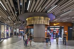 Column design / Signage / Ceiling design / Mall corridor at Shaw Centre Singapore by DP Design