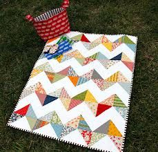 cute Charm pack quilt - love the stripe binding