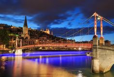 """Passerelle light trail. - Light trail of a tour boat sailing under illuminated Passerelle Paul Couturier.  Vieux-Lyon, Saint Georges church and Fourviere cathedral in the background under a cloudy dusk.  I wanted to take this shot for a while now. Last night the weather was about right and the tour boat was right on time :-)  If you like my work, you can follow me at <a href=""""https://www.instagram.com/sandervdw/"""">INSTAGRAM </a> for a near daily feed."""