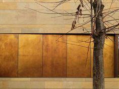 brass sheets brass siding on building exterior