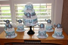 Elephant Diaper Cake Bundle;Blue & Gray Elephant Theme Diaper Cake;Elephant Theme Baby Shower Decorations;Blue Grey Chevron Diaper Cake by EveryLittleDetailLLC on Etsy https://www.etsy.com/listing/239659858/elephant-diaper-cake-bundleblue-gray
