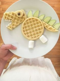 a simple and fun breakfast for kids using Eggo Waffles to make an edible dinosaur. It's fun food to fuel your child's mind!Create a simple and fun breakfast for kids using Eggo Waffles to make an edible dinosaur. It's fun food to fuel your child's mind! Kids Cooking Recipes, Cooking With Kids, Baby Food Recipes, Snack Recipes, Easy Cooking, Healthy Cooking, Cooking Games, Cooking Steak, Cooking Salmon