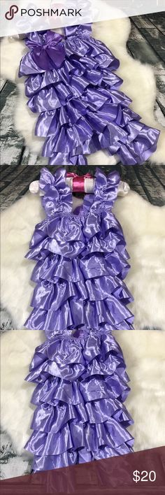 """Purple Satin Infant Romper NWOT. Size tag says medium which is approximately 9 months and up. Purple satin ruffle romper for baby girls.   *You do not have permission to use my photos unless I specifically give you permission* **It is not my responsibility if an item """"doesn't fit"""". Please ask for measurements before buying** One Pieces"""