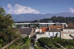 nuno ladeiro + marco martins inserts cubed apartment building into vila nova de tazem, portugal