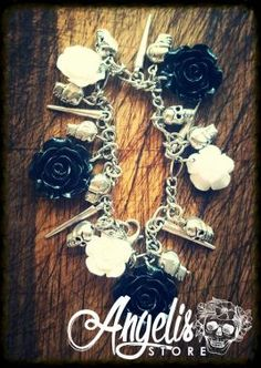 Black and White Rose Charm Bracelet With Skulls and Vampire Spikes Spikes, White Roses, Skulls, Charmed, Black And White, Bracelets, Stuff To Buy, Jewelry, Cnd Nails