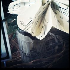 Sheet music flower centerpiece at The White Hawk Music Cafe