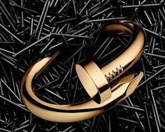 """Cartier's Resurrection Collection: Labeled the Juste un Clou or in English, Just a Nail collection, Cartier first designed the line back in the 1970's, in order to show in their words a, """"Rebellious nature and reflection of self-belief."""" While some take that to mean Studio 54, we feel like it's more on par with Jesus of Nazareth, than an overplayed coke den."""
