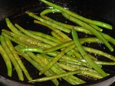 VEGGIES :: Pan Roasted Green Beans :: Just a cast iron skillet, 20 minutes & some green beans, olive oil, butter, lemon zest, salt & pepper. (You can also do them in an oven--Caprial & John recipe here: http://www.caprialandjohnskitchen.com/recipes/pop/3132.php Heat a sheet pan in the oven at 425 deg. Blanche & shock the beans. Then toss them & other ingredients & spread in 1 layer on a very hot sheet pan & cook in the oven al dente about 5 minutes.) | #greenbeans #roastedvegetables…