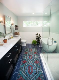An all white bathroom gets an amazing update — starting with cerulean blue tiled floors. Click through to see the amazing renovation. It just might inspire you.....