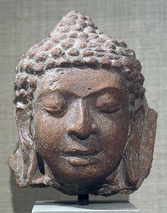 Head of a Buddha Period: Mon-Dvaravati period Date: 8th century Culture: Thailand Medium: Terracotta