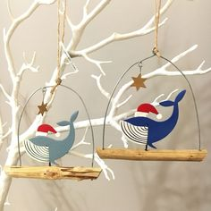 Christmas whales wearing Santa hat on stick.Hanging christmas decoration.star