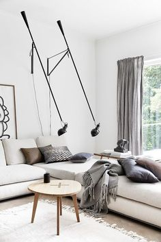 white and grey living with with interesting light fixtures #livingroom #inspriation
