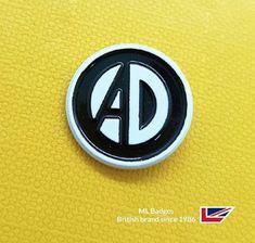 Striking small badge, white dye with black soft enamel - nice. Name Badges, Pin Badges, Make Your Own Badge, Custom Badges, Volkswagen Logo, Buick Logo, Charity, Enamel, Nice