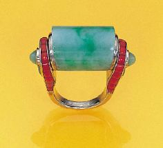 A JADEITE AND CORAL RING