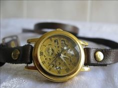 Awesome gold and leather wrap around wrist watch...