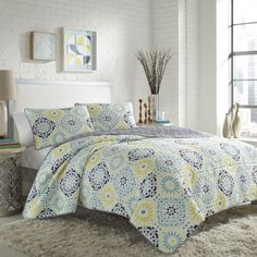 Let the sunshine into your bedroom with this bright comforter set. Decorated with a darling blue and yellow pattern, this upbeat bedding reverses to an indigo lattice pattern and is crafted with pre-washed cotton for softness.