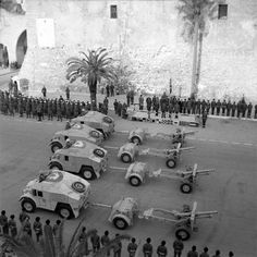 25-pdr field guns and 'Quad' artillery tractors parade past Winston Churchill during his visit to Tripoli to thank the 8th Army