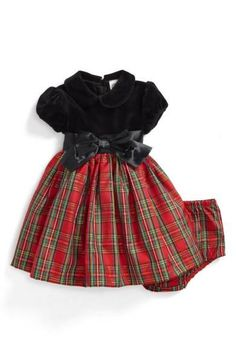 Subtle shimmer adds to the holiday-worthy appeal of this darling fit-and-flare dress featuring a colorful plaid skirt and grosgrain ribbon at the waist.
