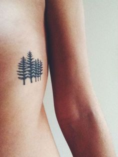 i like the idea of a line of trees 52 Nature Inspired Tattoo Designs