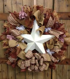 Primitive star wreath by WilliamsFloral on Etsy, $75.00. Would be really cute to do with red whit and blue. Use as an idea