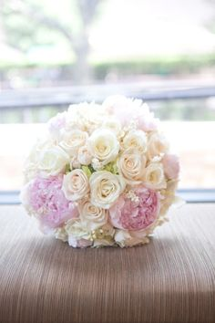 pink peonies, cream and peach roses and lilly of the valley.