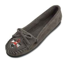Minnetonka Women's Grey Suede  Thunderbird II Moccasin.    Product # 601T    Soft, supple suede leather moccasin with colorful, beaded Indian Thunderbird design sewn across the toe accented by whip-stitching detail. This Minnetonka classic has a decorative kilty layer of fringe topped off with a thin leather bow and wrap around laces for a custom fit. Slip-on comfort with a fully padded insole.    Color: Grey Suede    Sizes: 5, 5 1/2, 6, 6 1/2, 7, 7 1/2, 8, 8 1/2, 9, 9 1/2, 10, 11