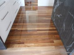 Grey and white kitchen with spotted gum floor