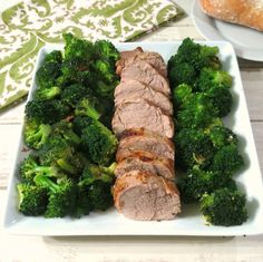 Herb Roasted Pork Tenderloin and Steamed Broccoli - Tender, juice herbed roasted pork tenderloin served with a flavorful garlic infused steamed broccoli.