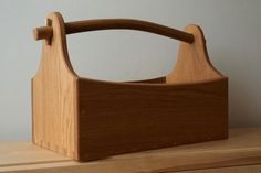 This tool carryall is constructed from salvaged oak and features a curved handle. #steambending #woodworking
