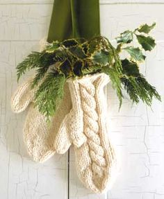 Mittens with greenery instead of a wreath for the front door.