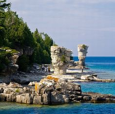 Flowerpot Island, Ontario gets its name from two rock formations on its eastern shore. A local legend says that two lovers from warring tribes eloped to the island and were somehow turned to stone. A profile of a face is visible on one of the stones if you view it at the right angle. The island is part of The Fathom Five National Marine Park and is a popular tourist destination.